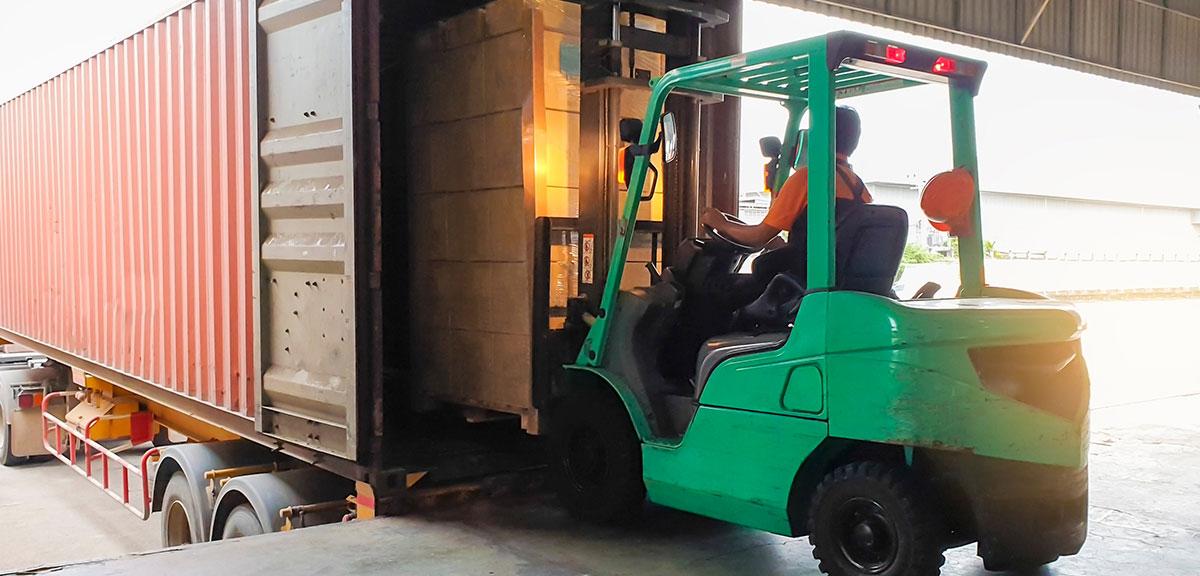 forklift loading a truck